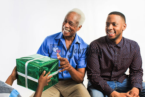 Grandpa Receiving Gifts With Family