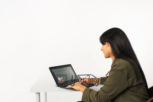 Woman Looking At Laptop While Typing