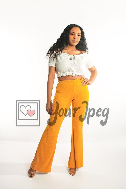 Woman posing in yellow pants