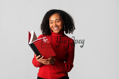 Woman Smiling While Reading Open Book #1