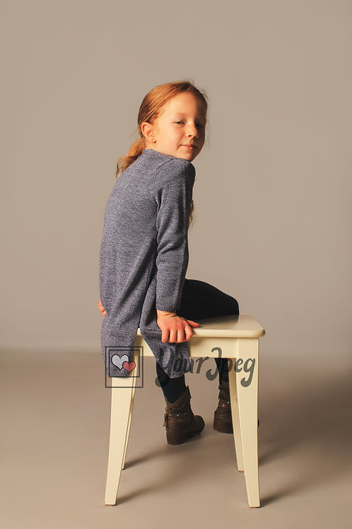 Girl Sitting On Table Modeling Looking Back