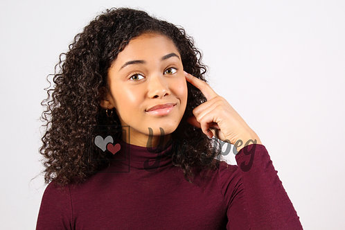 Teen girl thinking looking at camera