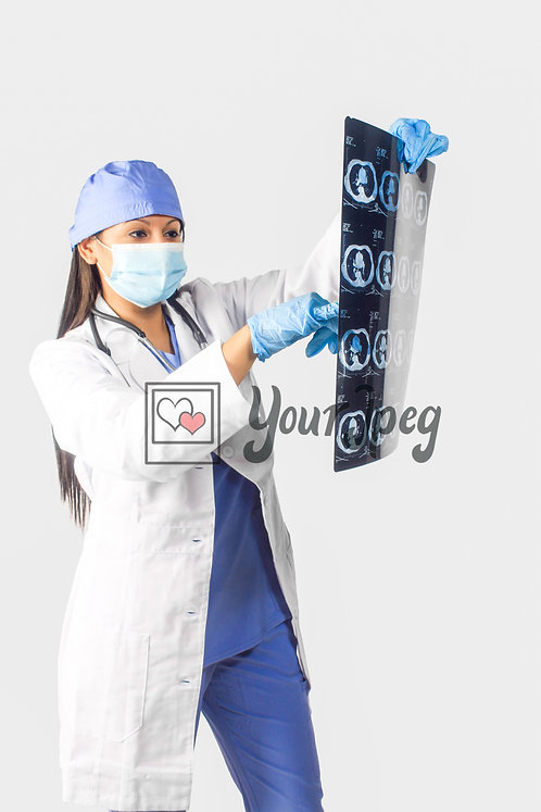 Female Doctor Pointing At X-Rays #2