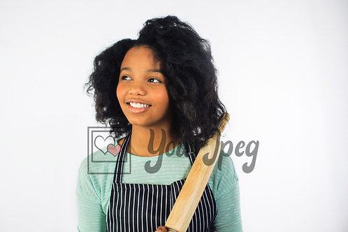Tween cook looking away smiling