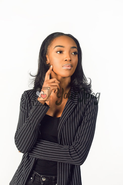 Woman In Suit With Hand On Face
