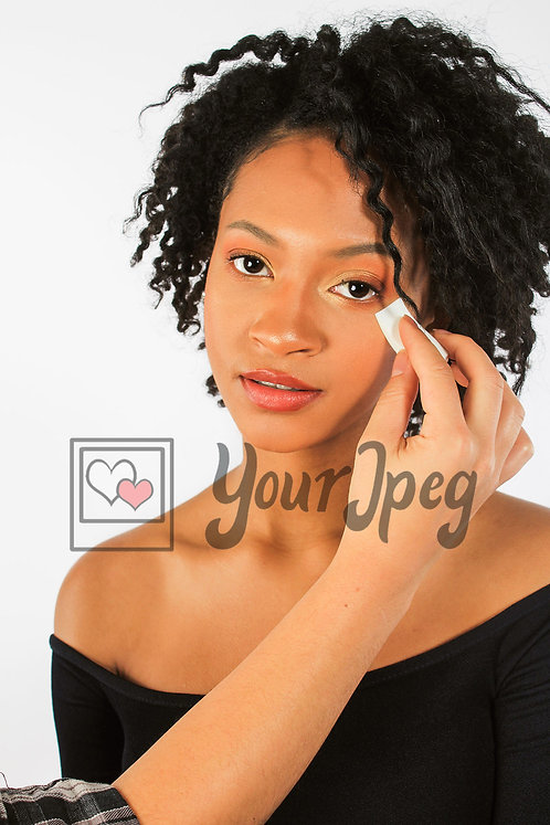 Woman Applying makeup under the eye