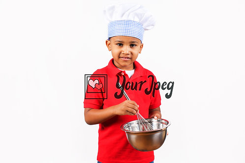 Young boy chef holding whisk and bowl