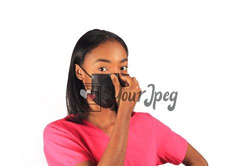 Female Nurse Adjusting Face Mask At Nose