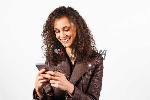 Woman smiling looking at phone texting