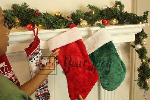 Hand holding Christmas stocking