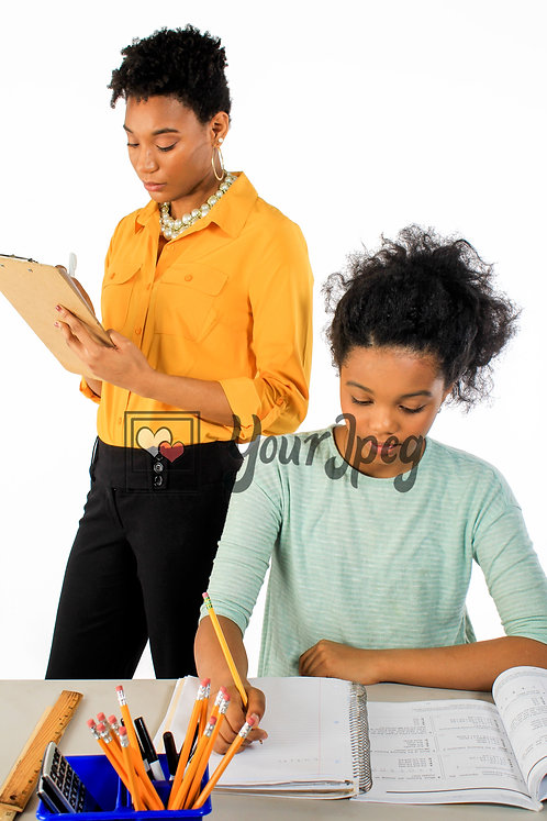 Teacher writes on clipboard as student completes taskstudent II