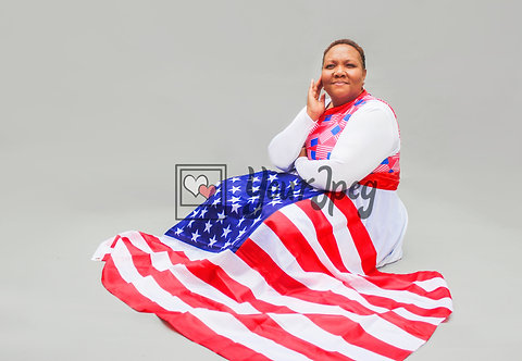 Woman sitting with flag laying on her lap