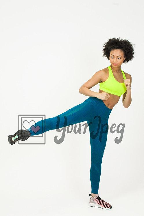 Woman exercising kicking up leg