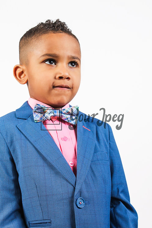 Boy wearing suit looking up