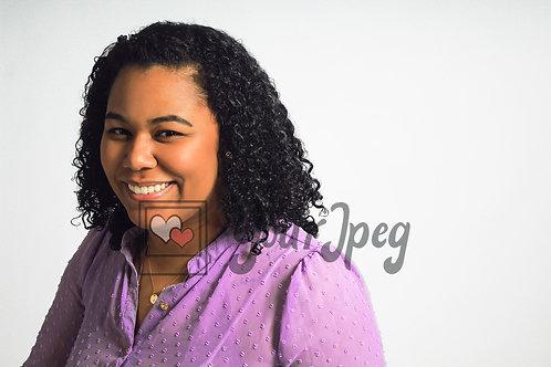 Woman smiling wearing purple shirt