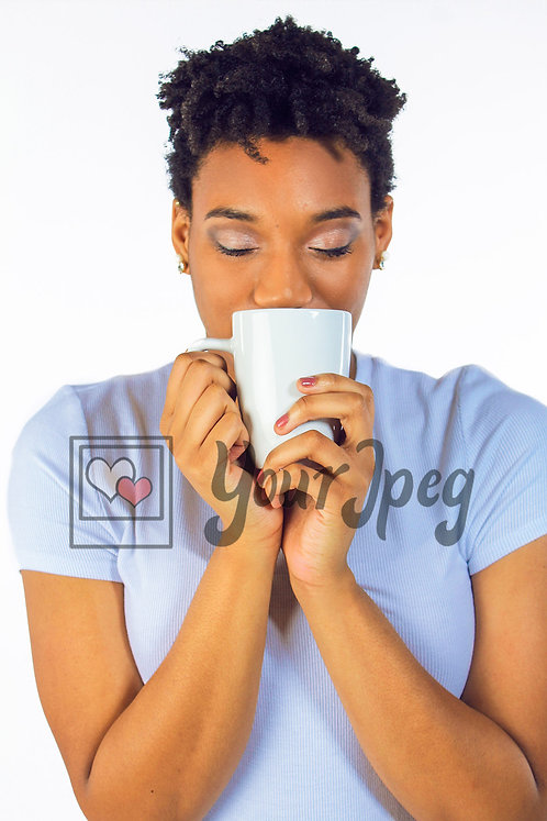Beautiful woman smelling beverage 2