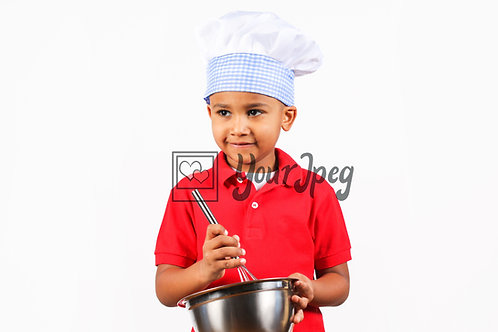 Boy chef smiling looking away