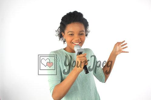 Tween girl singing facing front