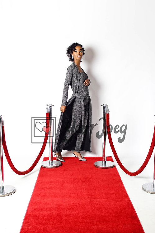Woman Posing On Red Carpet While Holding Coat