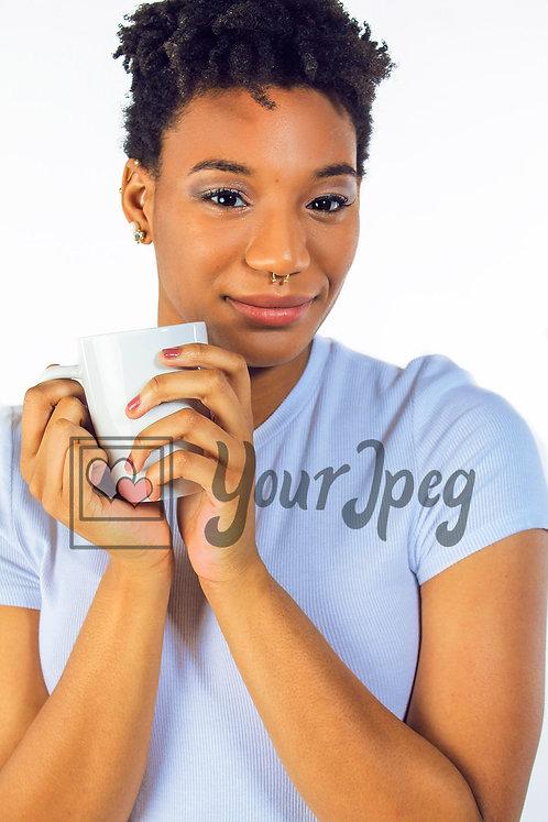 Beautiful woman holding mug