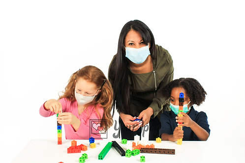 Woman Playing With Kids While Wearing Mask And Looking Forward
