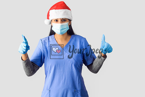 Female Nurse Wearing Christmas Hat, Gloves, And Mask With Thumbs Up