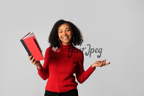 Woman Smiling While Holding Open Book #3
