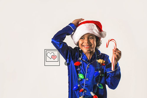 Boy Wearing Christmas Hat And Lights While Holding Candy Cane #7