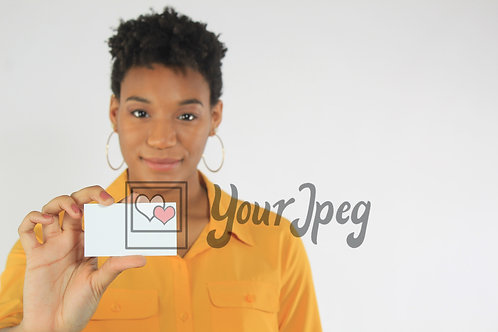 Woman holding up blank card 3