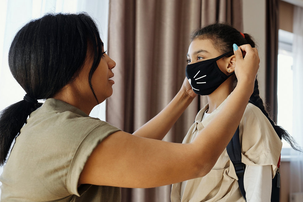 mother-putting-a-face-mask-on-her-daught