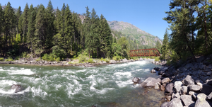 A beautiful picture of the Wenatchee River and of the Red Bridge at the Old Pipeline Bed Trail