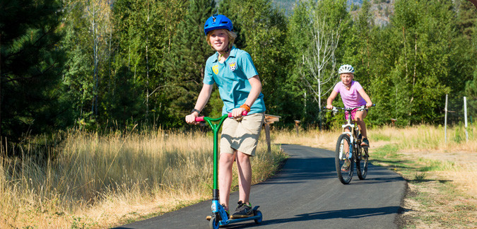 Children ride bikes on paved, wheel chair accessible trail at Sleeping Lady Mountain Resort, Leavenworth, WA