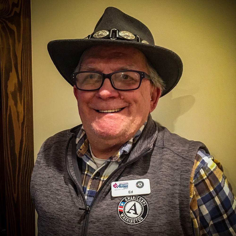An Americorps Volunteer named Ed smiles