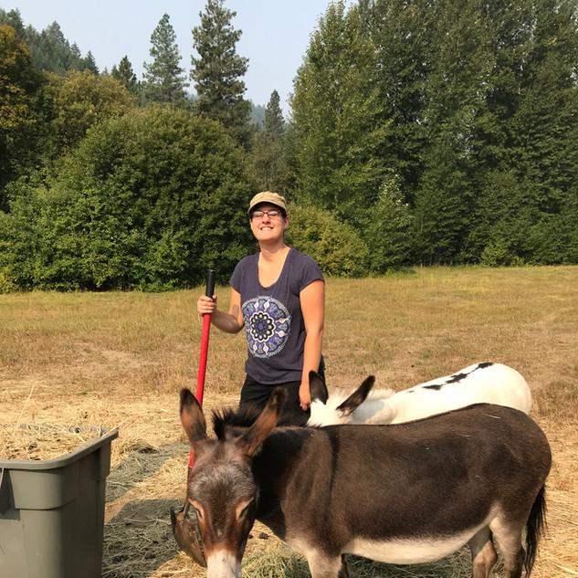 Grace with donkeys.jpg