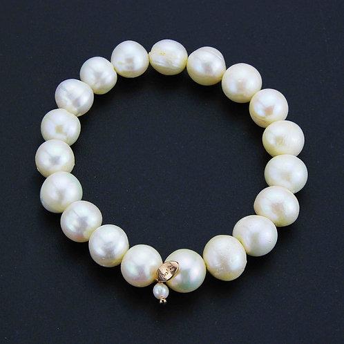 Bracciale elastico perle bianche coltivate 11 mm