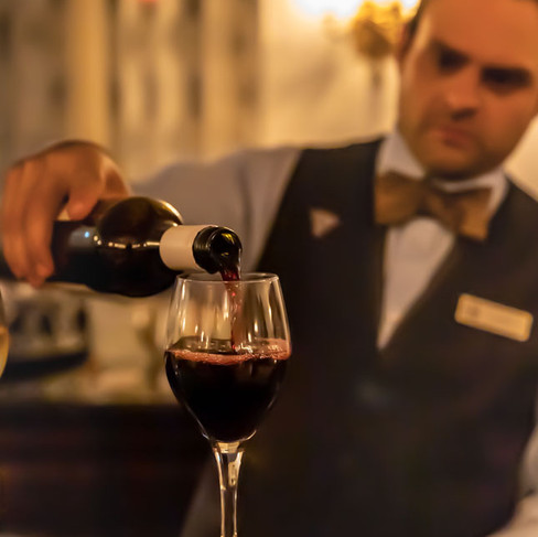 Waiter pouring red wine in a glass_Fairmont Royal York Hotel_Food Photography_Bonjour Tast