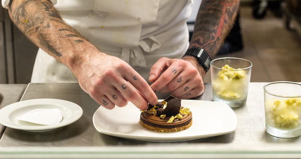 Stratford Chef School student plating a