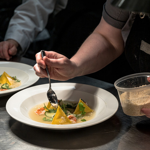 Chef Angela Murphy plating a dish_Stratford Chefs School Dinner with Guest Chef Angela Mur