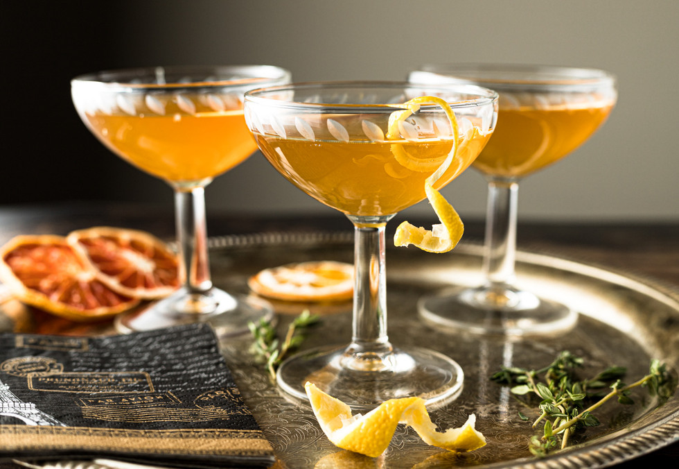 Cocktail Drinks with Lemon Peel on a Tra