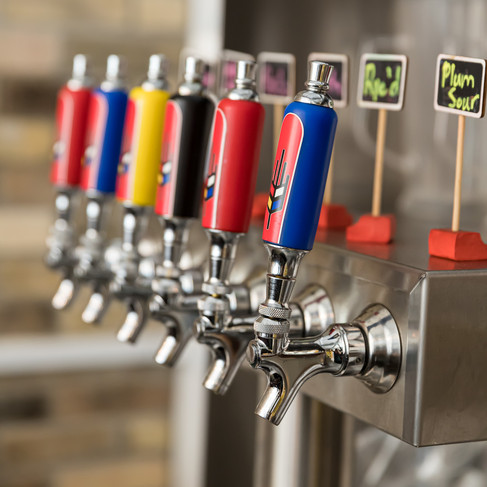 Beer Taps in different colours_ Bitte Schon Brewery _Restaurant Photography_Bonjour Tasty