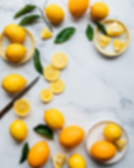 Lemons on a white marble background_Food