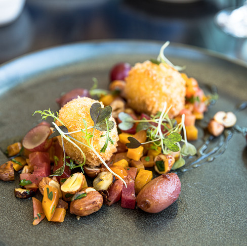 2 Crispy Cheese Balls with nuts and grapes on grey plate_Elora Mill_Food Photography_Bonjo