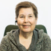 Marlene Thacker, Behavior Consultant. Woman with short brown har with Bluetooth in her right ear.