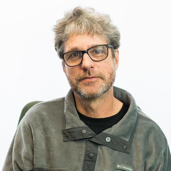 Charlie Stevenson, Behavior Consultant.  Man with short graying brown hair, glasses, and short beard.