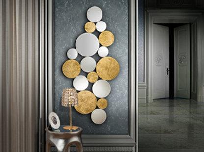 Espejo formado por círculos de lunas biseladas y cristal con fondo en pan de oro