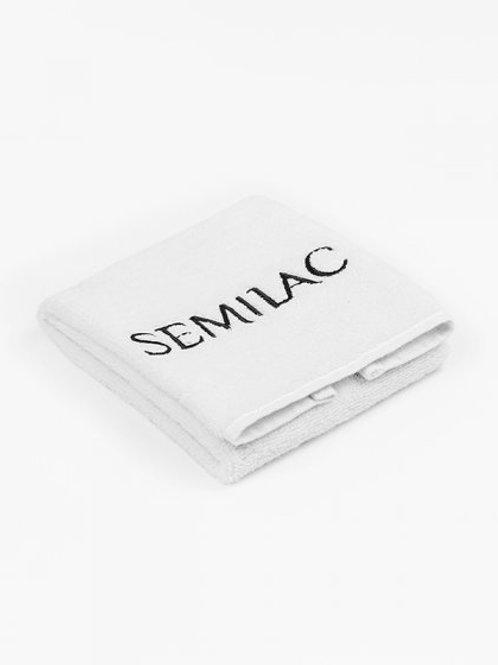 Toalla blanca con logo negro Semilac