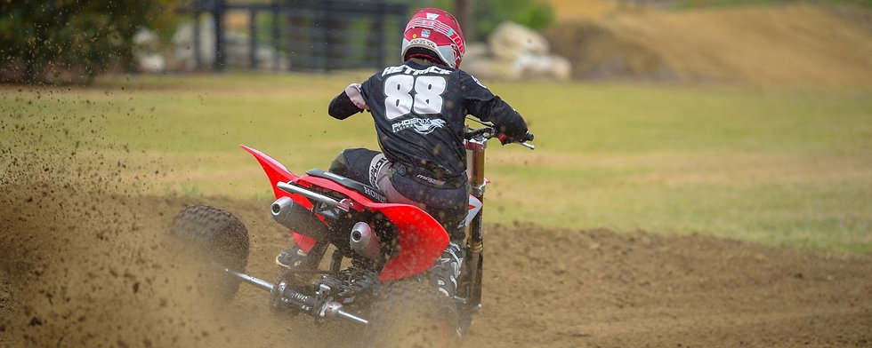 Joel Hetrick on a 3 wheeler.jpg