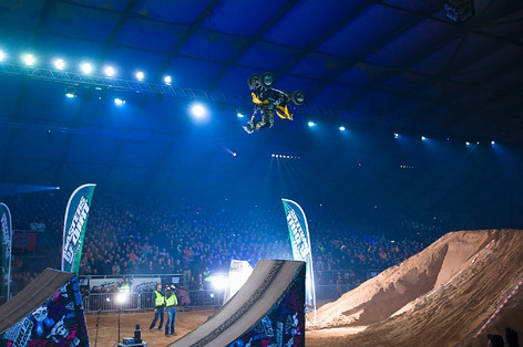 Jon Guetter backflipping in Vienna, Austria for Masters of Dirt Tour