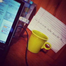 Working at the desk.