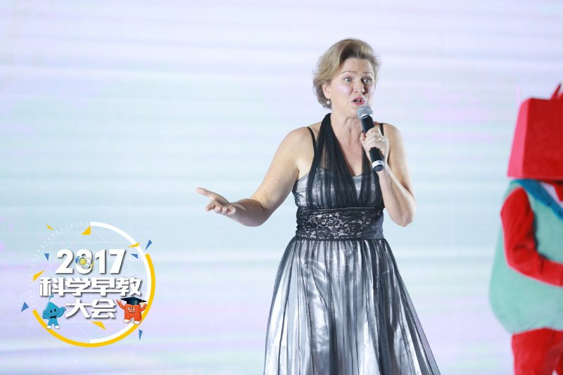 """Founder, Melanie Maslin singing """"Off We Go Exploring"""" at the National Conference on the Science of Early Childhood Education in Beijing."""